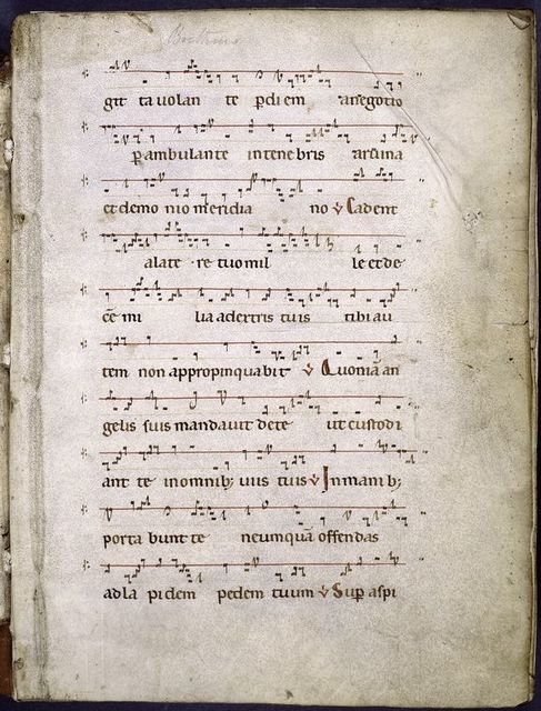Page of music and text. Staves with single red line.