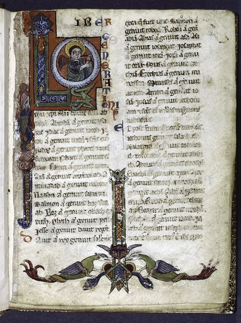 Large opening initial with angel of Matthew.  Border design with animals.  Rubric and red placemarkers.