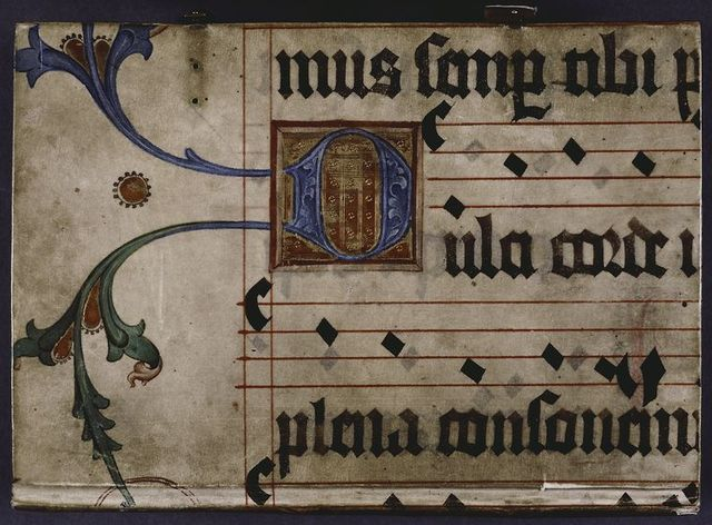 Front cover, large initial on gold field, with vines extending into border, and music.