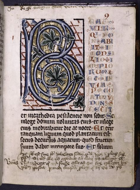 Initial with large scale foliage; red, blue and ochre gothic capitals form a panel adjacent to initial for the first verses of Psalm 1.