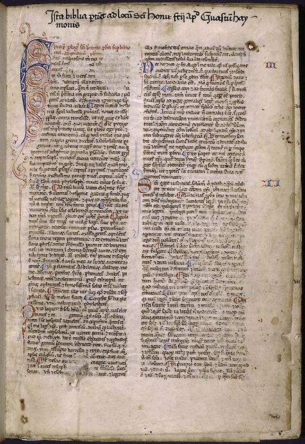 Opening of text, with large and small initials, rubric, placemarkers, name of book and chapter number in red and blue, note of ownership.