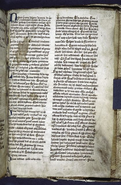 Text of early 14th century(?) folio.  Blue initials and yellow daubs as placemarkers.