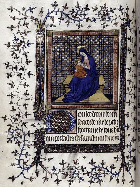 """Opening of section of prayers in French, """"Doulce dame de misericorde."""" Miniature of the Virgin and Child enthroned."""