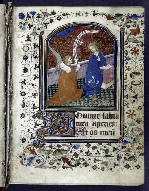 Opening of main text.  Miniature of Annunciation.  Border design, 3-line and 1-line initials, placemarker.