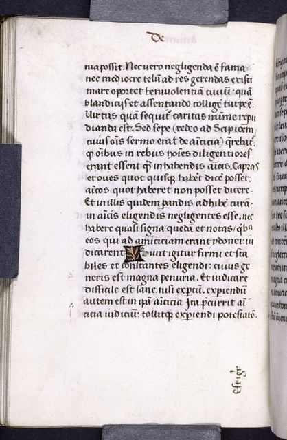 Page of text with catchword and 1-line red and gold placemarker.