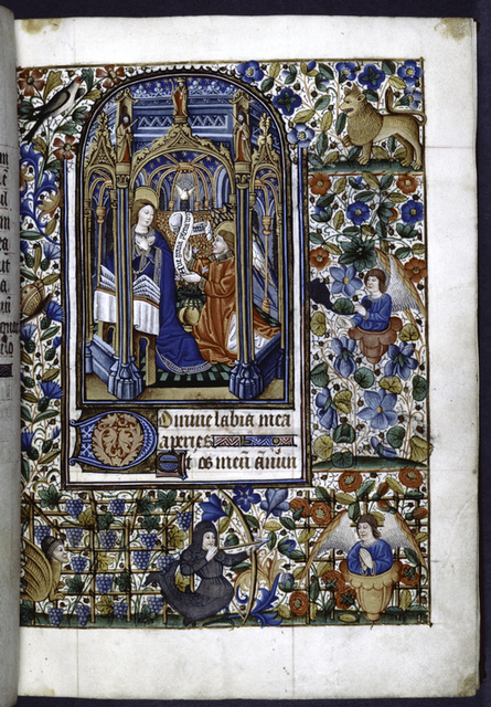 Annunciation set in an elaborate church; grotesques include an armored merman aiming an arrow at an angel that grows from a flower, with trellises of grapes and flowers in the background.