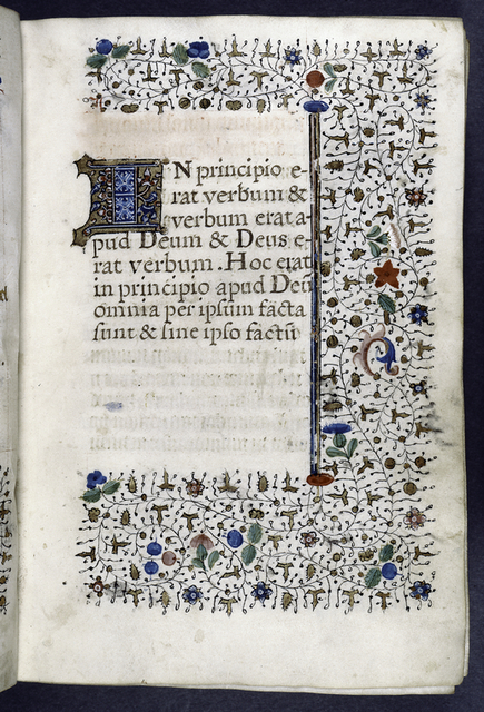 Opening of main text -- gothic script erased and humanistic written in.  3-line initial and border design.