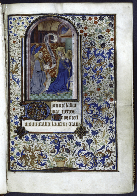 Opening of text.  Miniature of Annunciation, initials, full border design.