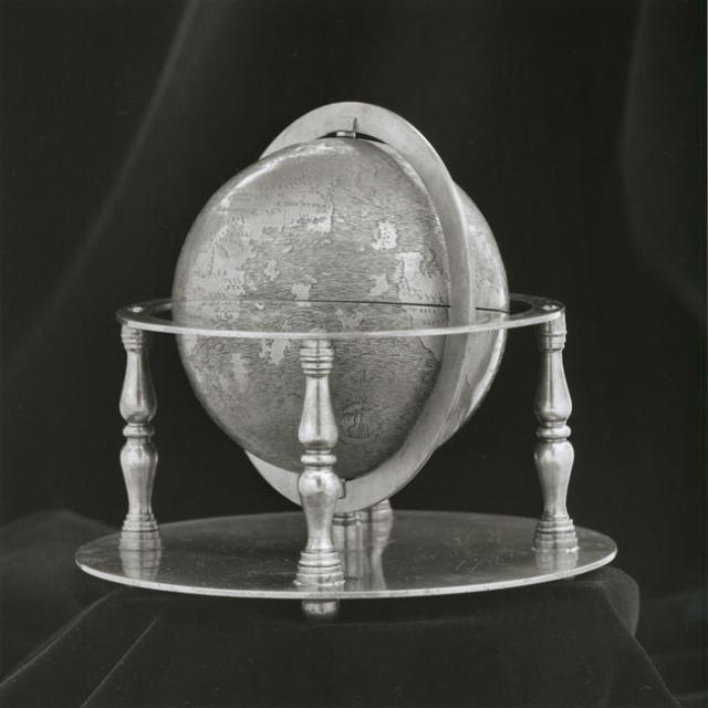 Full view of globe with stand.