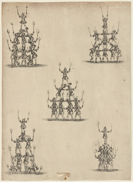 [Acrobatic dancers in human pyramids].
