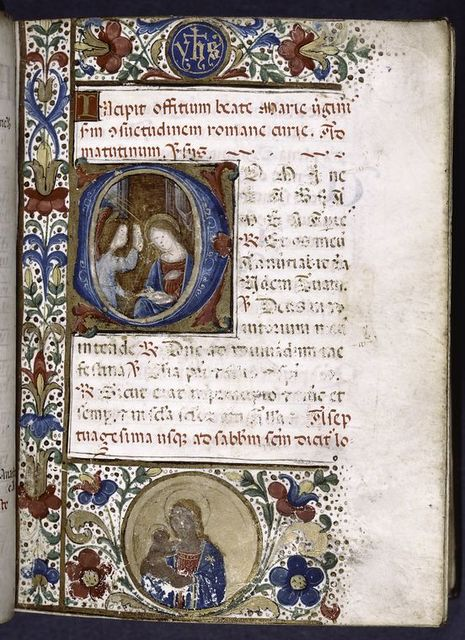 """Opening of main text, initial with Annunciation, small initial, rubrics and border design with two roundels containing portrait of Virgin and Child, and """"Yhs""""."""