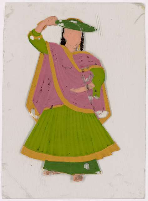 Dancing girl in green skirt, blue hat and pink scarf, left arm raised