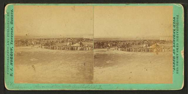 Indians sitting in large circles during the issuing of annuities at Ft. Berthold.