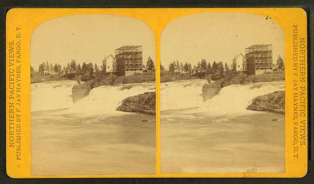 Spokane Falls from the north. [Showing mill and building under construction.]