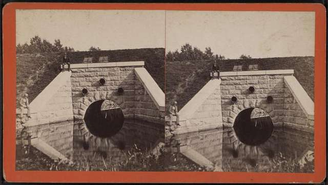 View of a culvert possibly beneath the Erie Canal, with reflection
