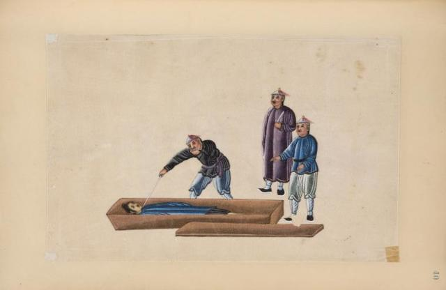 Man is laid in coffin and pierced through the neck with a sword.