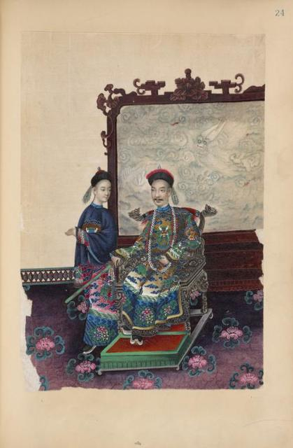 Man sitting on ornately carved chair in front of screen ; young attendant next to chair.
