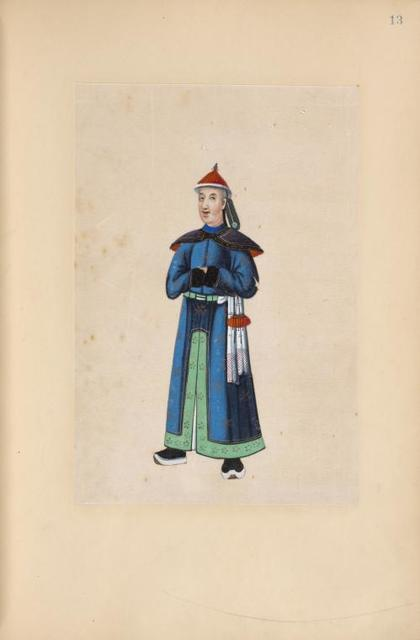 [Man wearing blue and green traditional gown.]