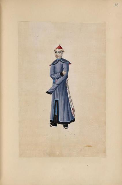 [Man wearing lavender traditional gown with long sleeves.]
