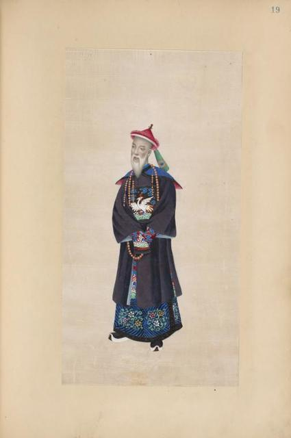 [Man with white beard wearing beaded necklace and tunic with design of large white bird.]