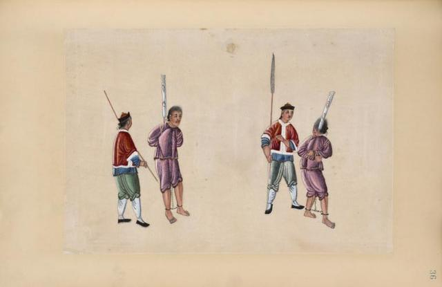 Two prisoners, bound hand and foot, are led by two guards.