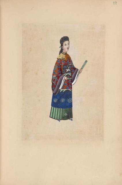 Woman holding a folded fan.