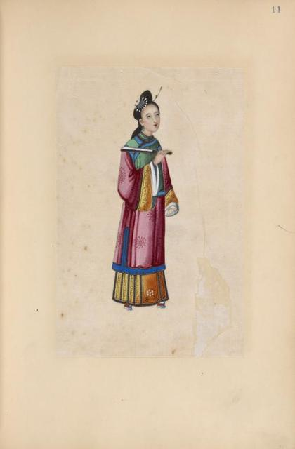Woman wearing pink and gold traditional gown, holding a folded fan.