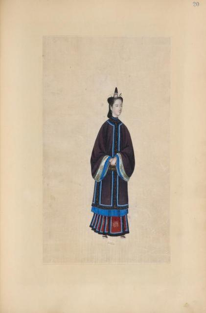 [Woman wearing purple tunic with blue trim and green cuffs.]