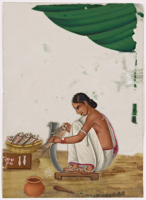 Seated female fishmonger in white sari