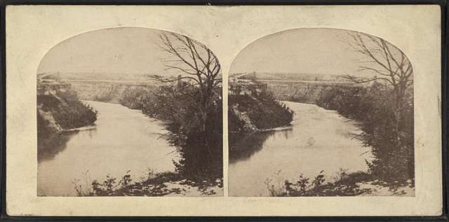 Suspension Bridge, Niagara. [Distant view, with river in foreground.]