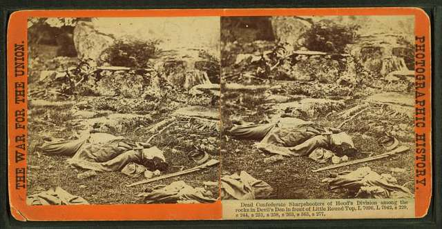 Dead Confederate sharpshooters of Hood's Division among the rocks in Devil's Den in front of Little Round Top.