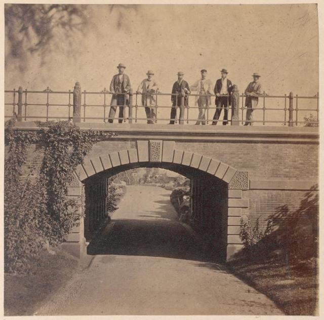 Men standing on Willowdell Arch.