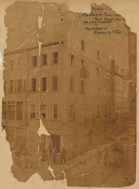 4 story brick building:  S. Barstow & Co. Broker, men standing outside