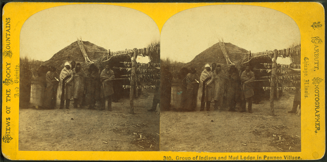 Group of Indians and mud lodge in Pawnee village.