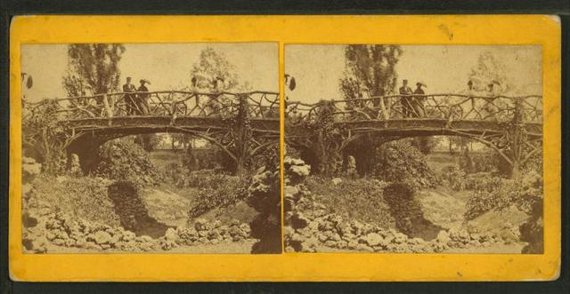 [Man and woman on wooden bridge.]