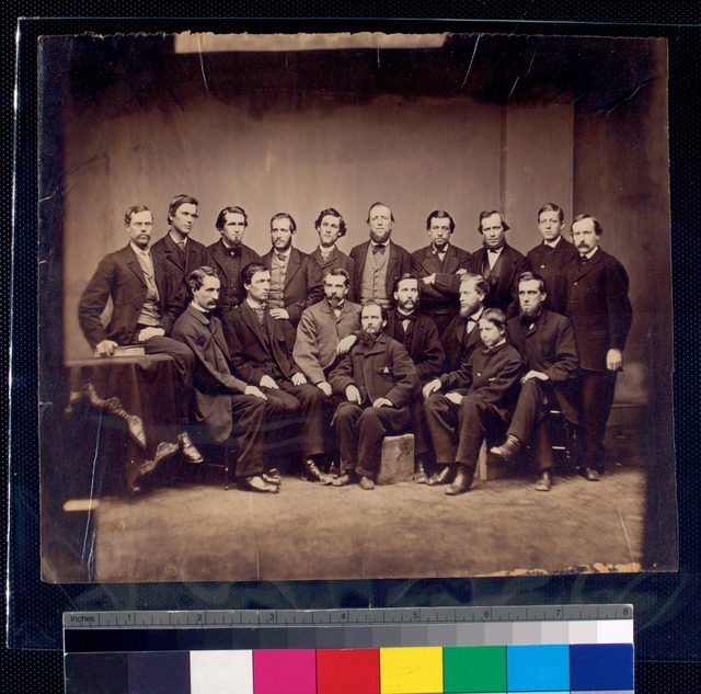 [Group of USSC personnel; eight seated in front, ten standing in rear.]