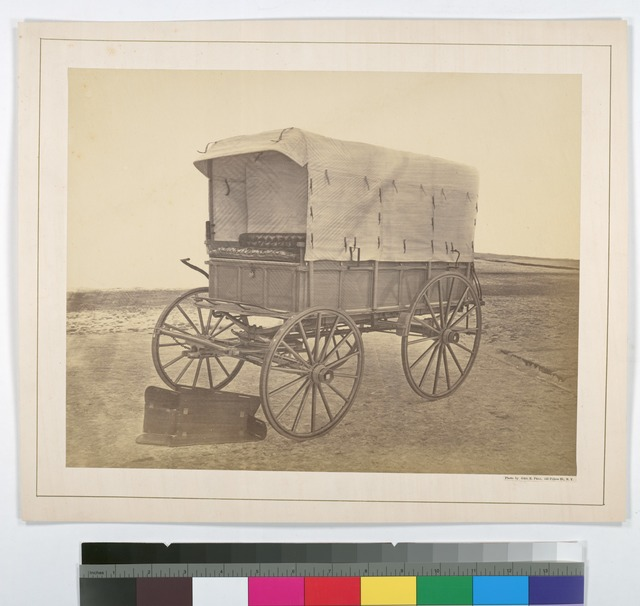 Howard ambulance, front and side view, interior view of opened wooden box (for limb support) on ground. Background masked.