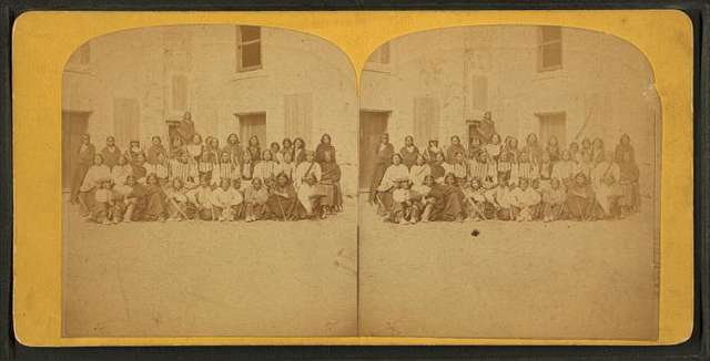 Group portrait of the Native American prisoners.