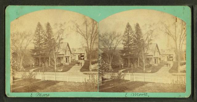 [View of a large house, white picket fence in foreground.]