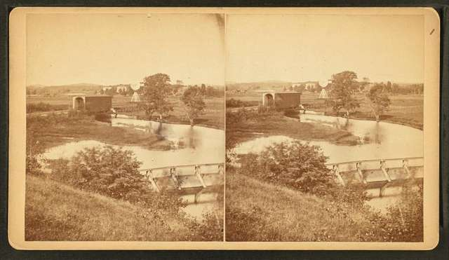 Boston Water works, Sudbury River Conduit, Nov. 6, 1876, south end of wooden dam on Sudbury River showing R.R. bridge and small bridge used for taking experiments with current water.