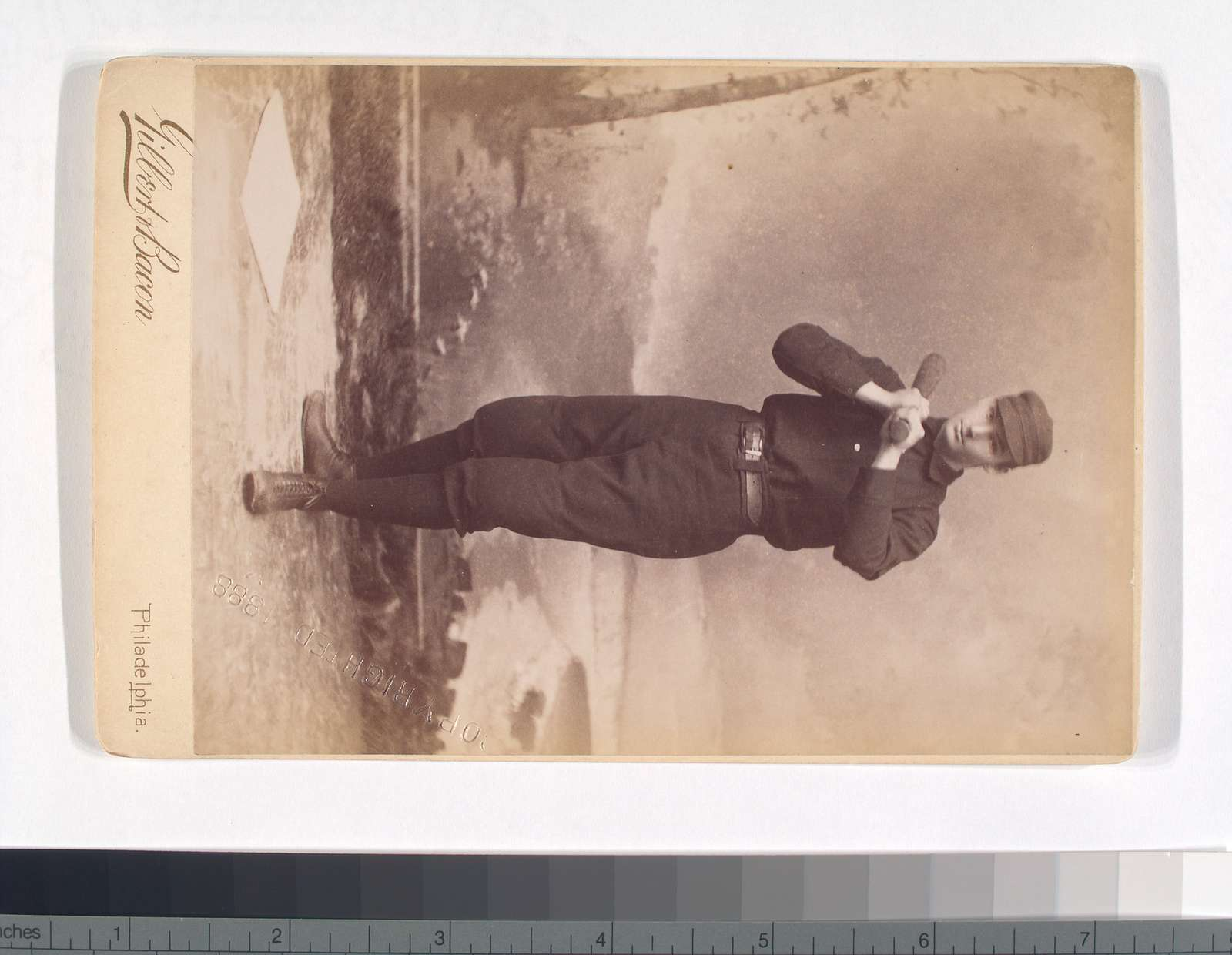 Unidentified baseball player in dark uniform - batting form -bat on shoulder
