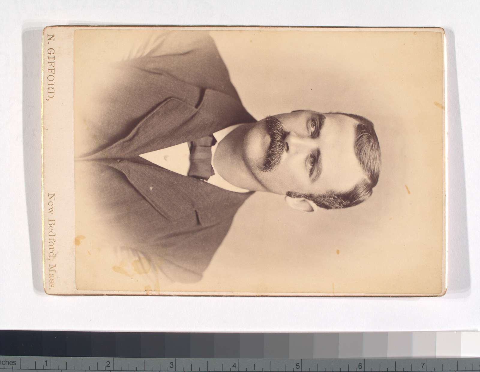 Unidentified man with mustache - wearing a suit and bow tie - portrait