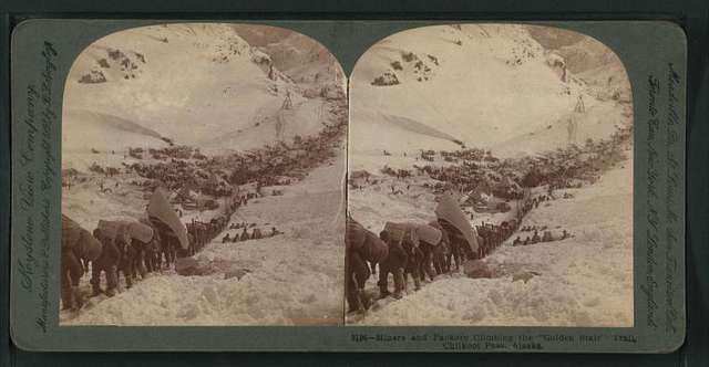 """Miners and packers climbing the """"Golden Stair"""" trail, Chilkoot Pass, Alaska."""