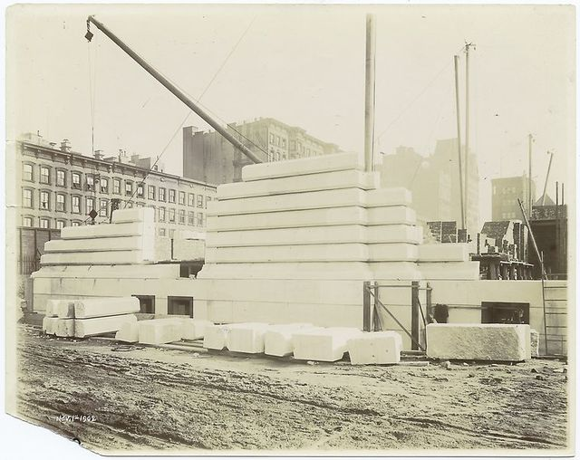 Exterior marble work : construction of the west facade, looking northeast.