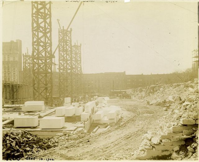 Foundation work : initial construction of exterior marble walls, northwest corner.