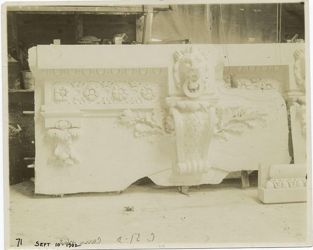 [Plaster model of architectural decoration to go above a window, including moldings, a keystone decorated with a volute, and a lion's head.]