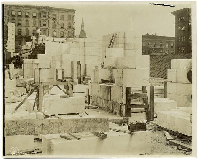 Interior work : marble blocks and construction of walls, facing northeast.