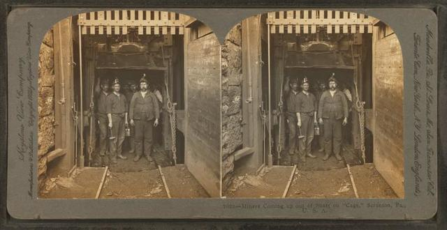 """Miners coming out of shaft on """"cage"""", Scranton, Pa., U.S.A."""