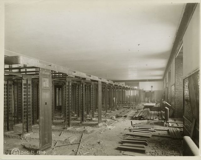 [Interior work : construction of bookcases in the stacks.]