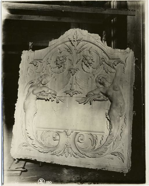 [Plaster model of a panel decorated with two winged nude female figures, cornucopias and leaves.]